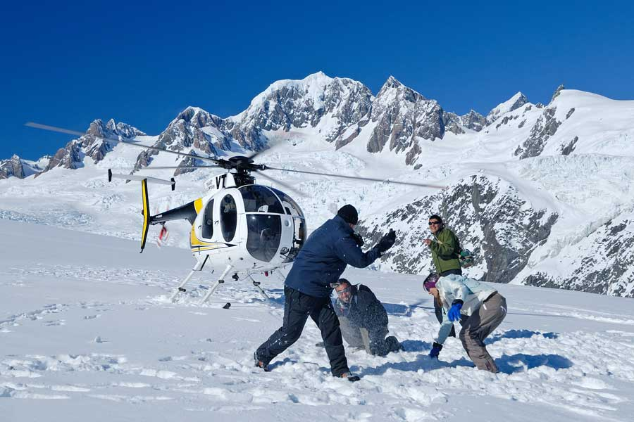 Glacier helicopter guided tour New Zealand with snow landing